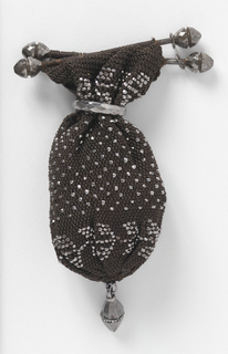 Very small bag of black silk crocheted net with cut steel beads and ring. Top finished with two bars.