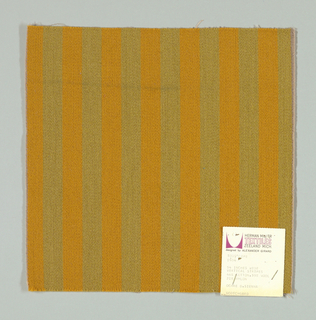 Warp-faced twill in vertical stripes of tan and dark gold. Plain weave binding foundation has light brown warp and weft threads.