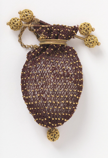Small sac of dark red crocheted silk with gilt beads, with a ring of plain gold to open or close. Top finished with two gold bars with gold knobs, single gold drop at bottom.