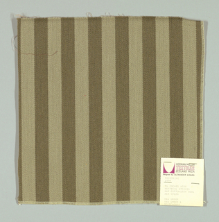 Warp-faced twill in vertical stripes of light grey and dark grey. Plain weave binding foundation has light brown warp and weft threads.