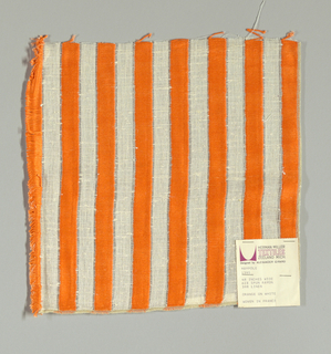 "White plain weave with 3/4"" inch vertical stripes in orange. Striped pattern is formed by discontinuous supplementary weft floats."