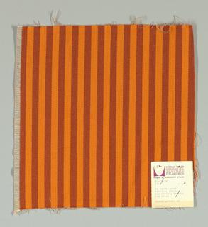 Warp-faced twill in vertical stripes of bright orange and dark orange. Plain weave binding foundation has light brown warp and weft threads.