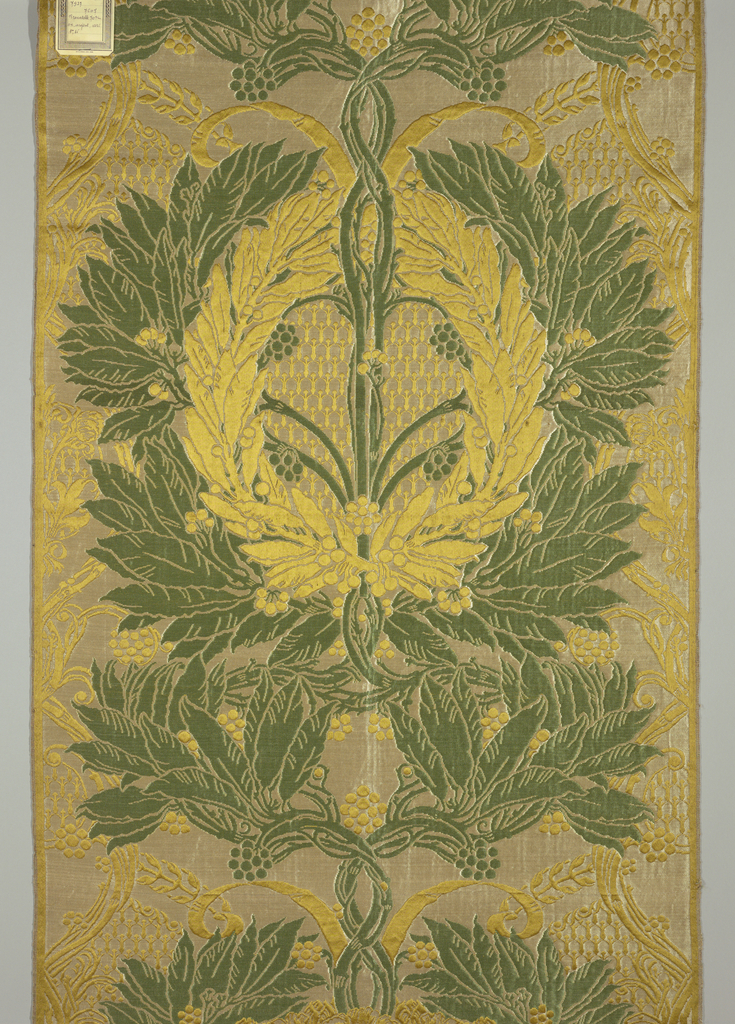 Sample of a figured silk twill with cotton backing. White twill ground with figure in gold silk and green silk. Vertical repeat of large-scale laurel wreaths. Designed for French embassies.