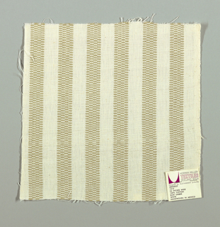 White plain weave with vertical beige stripes. Beige striped patterning is formed by narrow bands of supplementary warp floats.