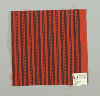 Crimson and black narrow vertical stripes with small crimson and black rectangles. Rectangular patterning is formed by supplementary warp floats.