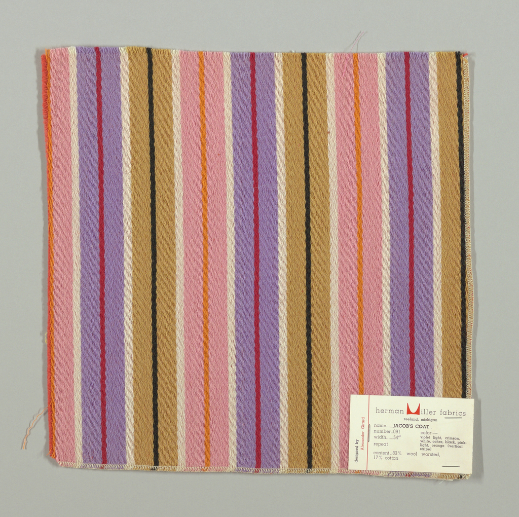 Warp-faced twill weave in broad and narrow vertical stripes of tan, white, lavender, red, pink, orange and black. Binding weft threads in dark pink on the reverse.