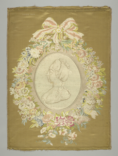 A woven portrait of the Comtesse de Provence is embroidered to the fabric that forms the frame. The frame is a wreath of multicolor flowers with a bow at the top.