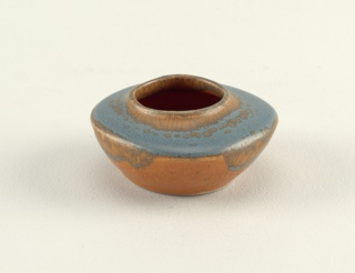 "Low wide bowl, shaped to rounded square at widest point.  Flat shoulder and small squarish neck.  Greenish blue glaze over (vanadium and iron) orange; body sand-colored.  Signed ""Chow"" (incised)."