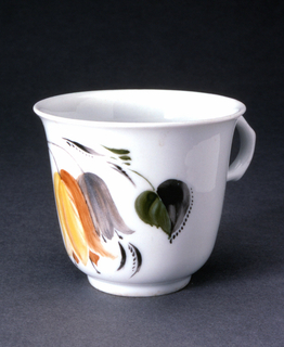 Small, rounded at bottom, flared at lip; loop handle; painted around sides with stylized flowers and leaves in yellows, grays, greens