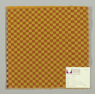 Double cloth in a gold and dark orange checkerboard pattern. The warp threads are light orange and dark yellow, and the weft threads are red and yellow. The dark yellow warp and yellow weft intersect and appear as gold. The light orange warp and red weft intersect and appear as dark orange.