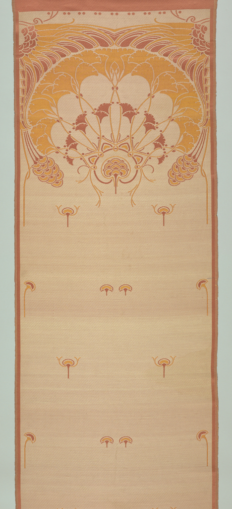 Vertical panel in terra cotta, orange and cream. Upper quarter of the panel has fan-shaped arrangement of blossoms adapted from Egyptian lotus. Small lotus motifs scattered over rest of the ground.