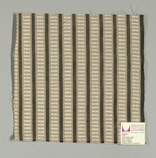 Beige and black vertical stripes with white rectangles. Rectangular patterning is formed by supplementary warp floats.