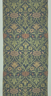Length of woven fabric with a deep blue ground and a stylized floral design. An ogival framework with alternating red and white roses at the points of intersection encloses symmetrical white tulip forms, with pale green leaves.