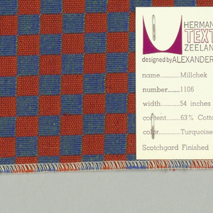 Double cloth in a red and blue checkerboard pattern. The warp threads are blue and orange, and the weft threads are green and red. The blue warp and green weft intersect and appear as blue-green. The orange warp and red weft intersect and appear as red-orange.