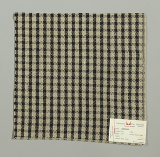 Plain weave checked pattern in black, beige and white.