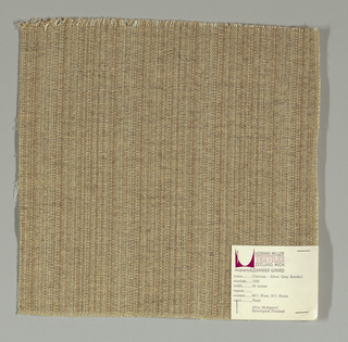 Plain weave with a light brown and white warp and beige weft. Warp is comprised of fine lightweight threads while the weft is a coarsely woven heavier yarn. The two colors of the warp produce a subtle vertical stripe effect.