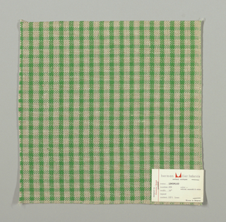 Plain weave checked pattern in green, beige and white.