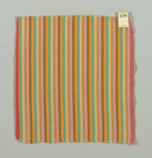 Warp-faced twill weave in narrow vertical stripes of pink, tan, light yellow, blue-green, light orange, and olive green. Binding weft threads in red-orange on the reverse.