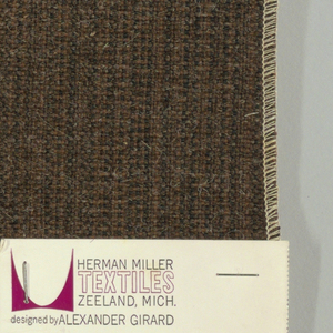 Plain weave with a tan and black warp and beige weft. Warp is comprised of fine lightweight threads while the weft is a coarsely woven heavier yarn. The two colors of the warp produce a subtle vertical stripe effect. Number 1500.
