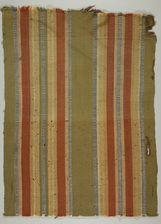 Hand-woven carpet with broad vertical stripes of various sizes, in tans, rust, blue and white.