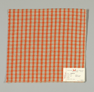 Plain weave checked pattern in orange, beige and white.