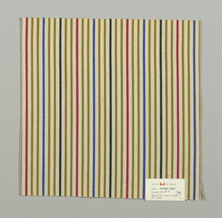 Warp-faced twill weave in narrow vertical stripes of white, blue, olive green, red and black. Binding warp and weft threads on the reverse.