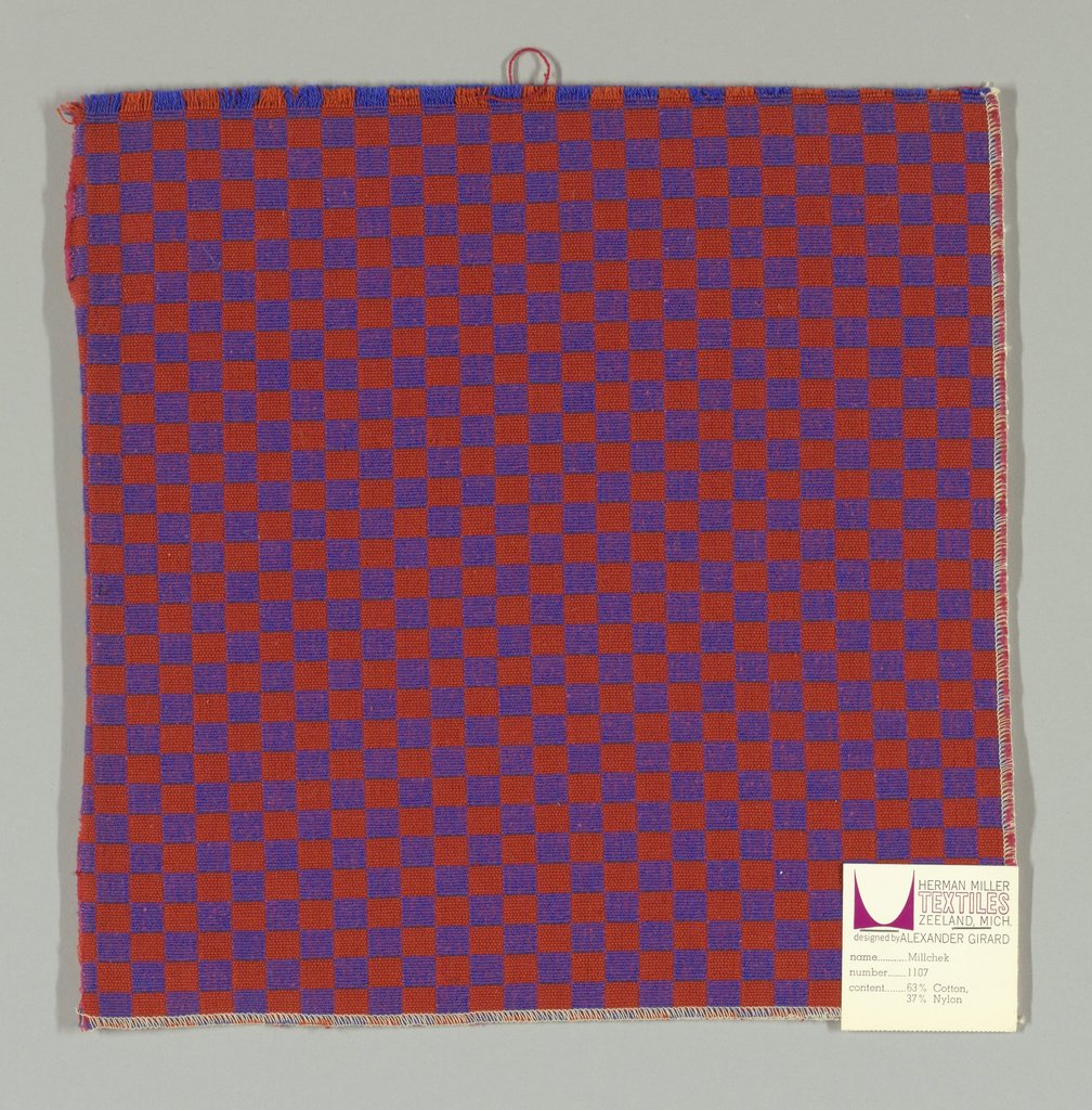 Double cloth in a red and purple checkerboard pattern. The warp threads are blue and orange and the weft threads are pink and red. The blue warp and pink weft intersect and appear as purple. The orange warp and red weft intersect and appear as red-orange.