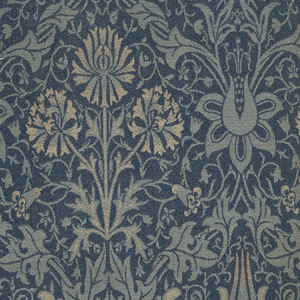 Woven furnishing fabric with vertically symmetrical ogival pattern of flowering plants, in light blue, yellow and orange on a dark blue ground.