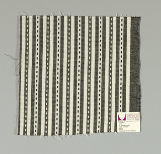 Black and white narrow vertical stripes with small black and white rectangles. Rectangular patterning is formed by supplementary warp floats.