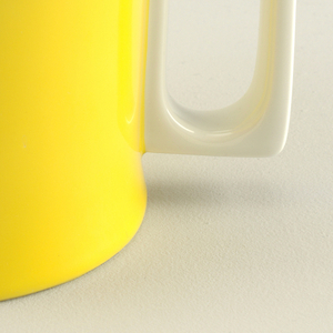 Tea/coffee pot (a): slightly concave squat cylindrical white body, exterior glazed yellow with white spout and pierced rectangular handle.  Circular lid (b) with inset flat circular knop;  white body glazed orange-yellow.