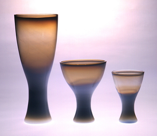 Small, of opalescent glass, with slightly flaring foot.