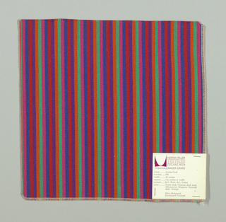 Warp-faced twill weave in narrow vertical stripes of pink, green, orange, violet, red and blue. Binding warp and weft threads on the reverse.