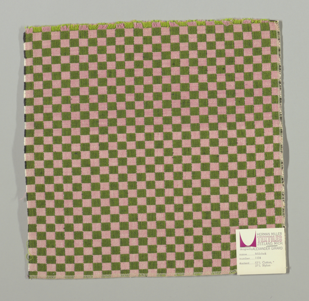 Double cloth in a light pink and olive green checkerboard pattern. The warp threads are pink and light green, and the weft threads are black and white. The pink warp and white weft intersect and appear as pale pink. The light green warp and black weft intersect and appear as olive green.