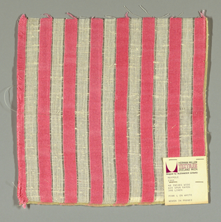 "White plain weave with 3/4"" inch vertical stripes in pink. Striped pattern is formed by discontinuous supplementary weft floats."