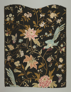 Slender curving vine winding up the center of the fabric with large and small flowers, stylized light blue birds and brightly-colored butterflies.