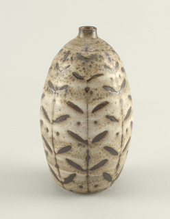 Ovoid body with small neck. Sgraffito decoration of vertical stems with leaves, brown on mottled white glaze.