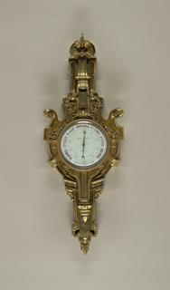 Barometer, with separte piece from the bottom of casing in box.
