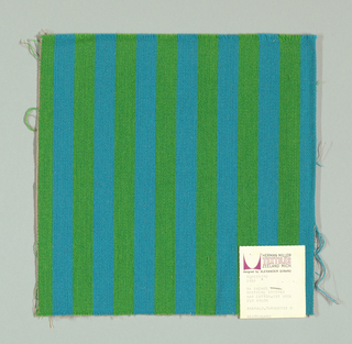Warp-faced twill in vertical stripes of green and turquoise. Plain weave binding foundation has light brown warp and weft threads.
