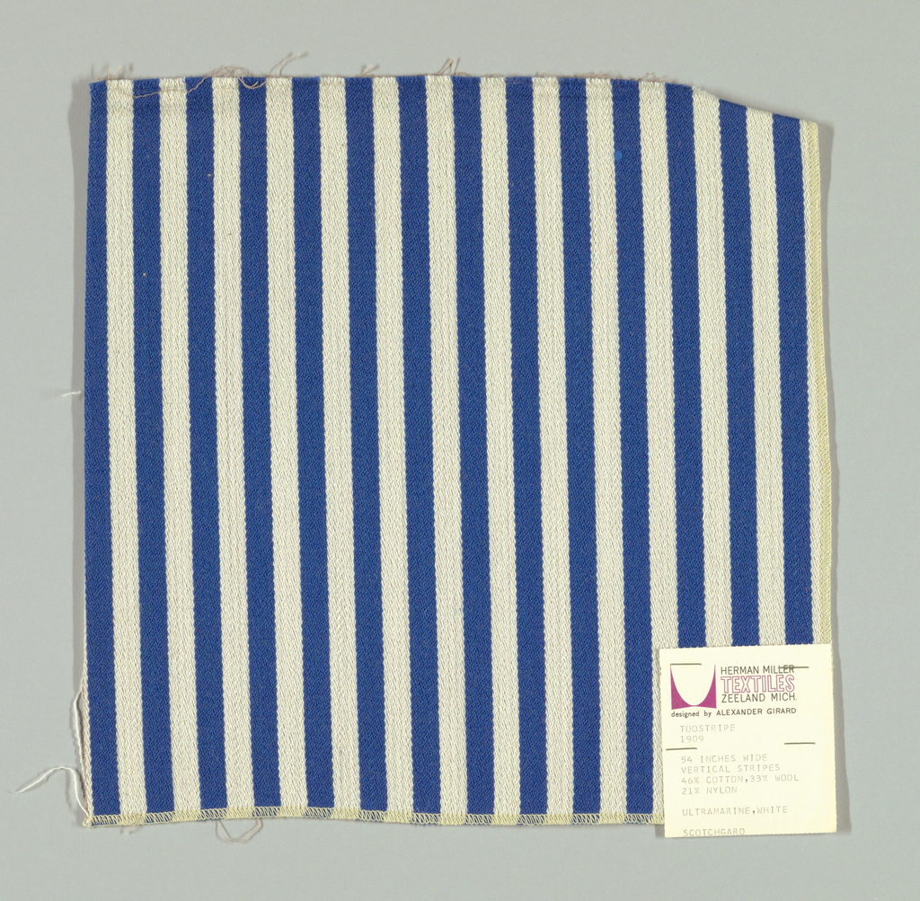 Warp-faced twill in vertical stripes of blue and white. Plain weave binding foundation has light brown warp and weft threads.