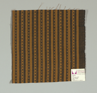 Light brown and black narrow vertical stripes with small light brown and black rectangles. Rectangular patterning is formed by supplementary warp floats.