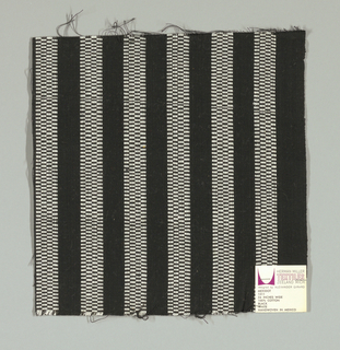 Black plain weave with vertical white stripes. White striped patterning is formed by narrow bands of supplementary warp floats.