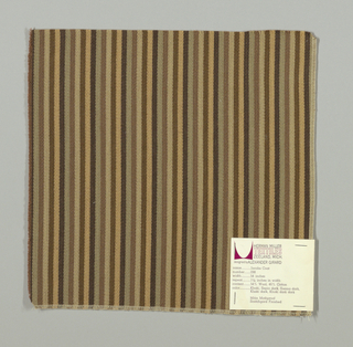 Warp-faced twill weave in narrow vertical stripes of dark brown, tan, brown, beige, light brown and taupe. Binding warp and weft threads on the reverse.