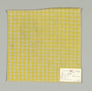Plain weave checked pattern in yellow, beige and white.