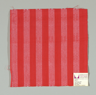 Crimson plain weave with vertical pink stripes. Pink striped patterning is formed by narrow bands of supplementary warp floats.