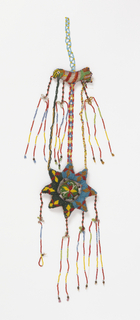 Hanging ornament with a stuffed, beaded bird and an eight-pointed star that hang from a bead chain. Bird has seven beaded chains that dangle from it, four of which have a three-dimensional effect, the other three supporting the star underneath. The star has four chains hanging from it. The star and bird have a different beadwork pattern on each side.
