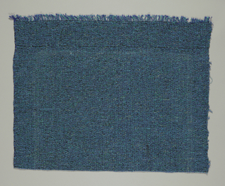 Hand woven in predominantly blue with textures and flecks of blues and metallic created by yarns.