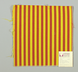 Warp-faced twill in vertical stripes of yellow and red-orange. Plain weave binding foundation has light brown warp and weft threads.