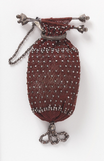 Crocheted red silk purse with cut steel beads, fitted with steel bars at top and steel ring to close; steel pendant at bottom.