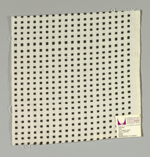 White plain weave with black squares. Square patterning is formed by supplementary warp floats. Number 1304.