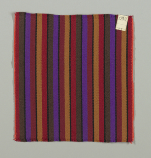 Warp-faced twill weave in broad and narrow vertical stripes of maroon, black, tan, violet and dark brown. Binding weft threads in orange on the reverse.